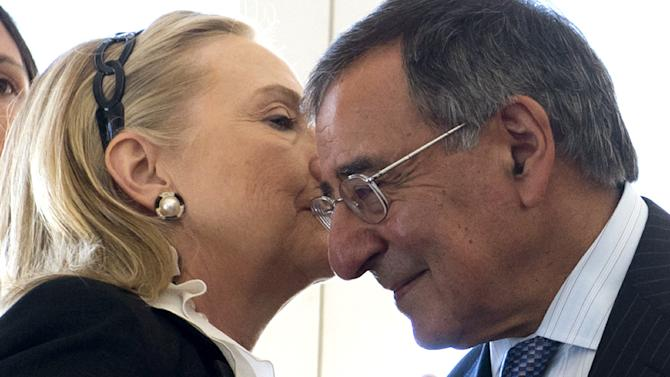 U.S. Secretary of State Hillary Clinton whispers in the ear of U.S. Secretary of Defense Leon Panetta during a reception hosted by Western Australia Premier Colin Barnett at the Indiana Teahouse at Cottesloe Beach near Perth Wednesday, Nov. 14, 2012. (AP Photo/Saul Loeb, Pool)
