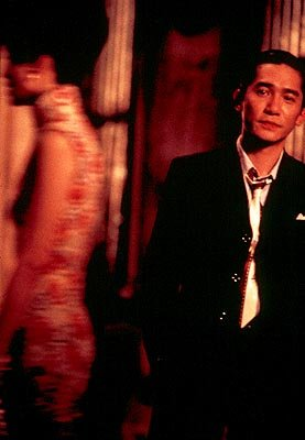 Maggie Cheung as Mrs. Chan and Tony Leung as Mr. Chow in USA Films' In The Mood For Love