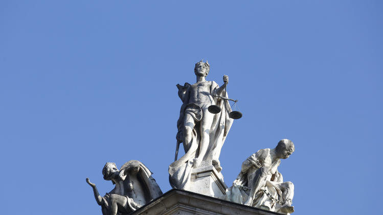 General view of a statue of Justice atop the regional court in Munich