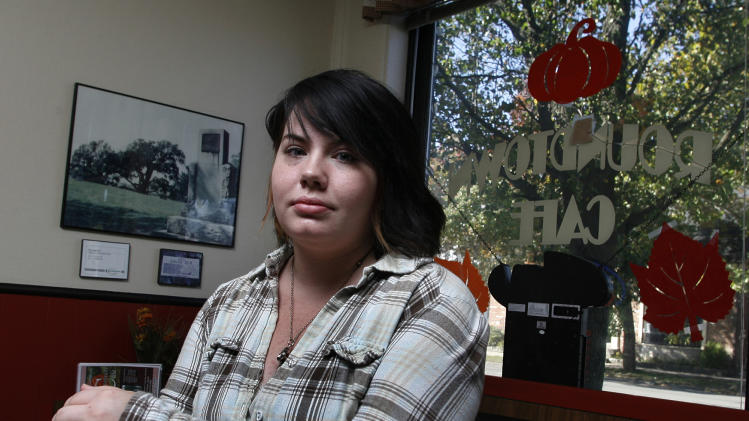 """This photo taken Oct. 26, 2012 shows Krista Brown, a cashier and server at the Roundtown Cafe in Circleville, Ohio. """"It's disgusting. You can't even relax and watch YouTube without these voices, these entities, yelling at you and we don't even know who they are,"""" said Krista Brown of Circleville, a small town about 30 miles south of Columbus, famous for its annual pumpkin festival. The 20-year-old waitress said the negativity had cost both parties her vote. (AP Photo/Mike Munden)"""