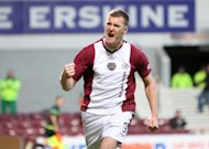 Former Hearts striker Kevin Kyle is delighted to be playing for Rangers