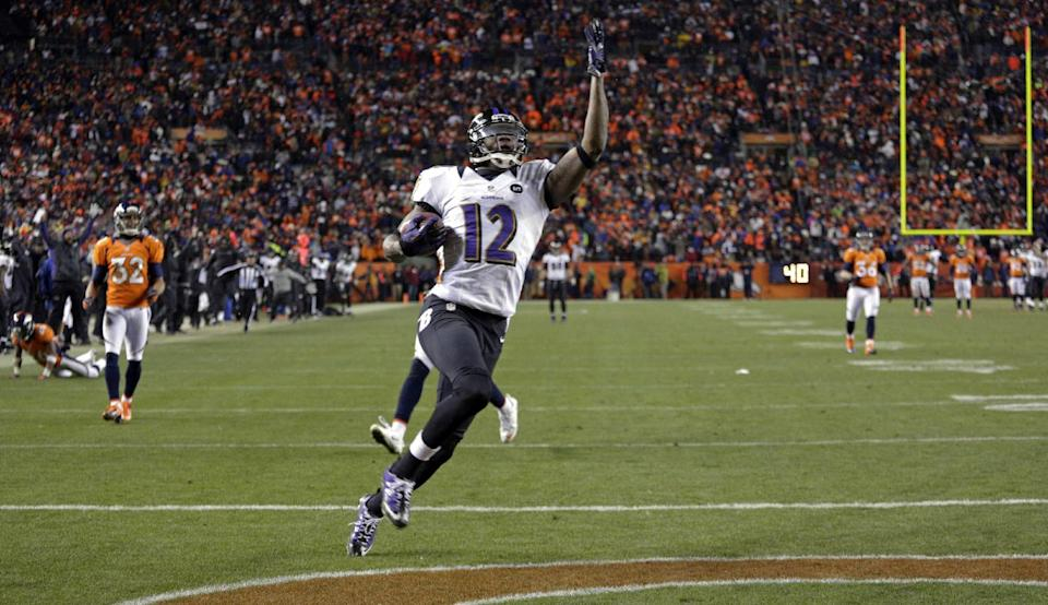 Baltimore Ravens wide receiver Jacoby Jones celebrates as he crosses the goal line for a touchdown against the Denver Broncos in the fourth quarter of an AFC divisional playoff NFL football game, Saturday, Jan. 12, 2013, in Denver. (AP Photo/Joe Mahoney)