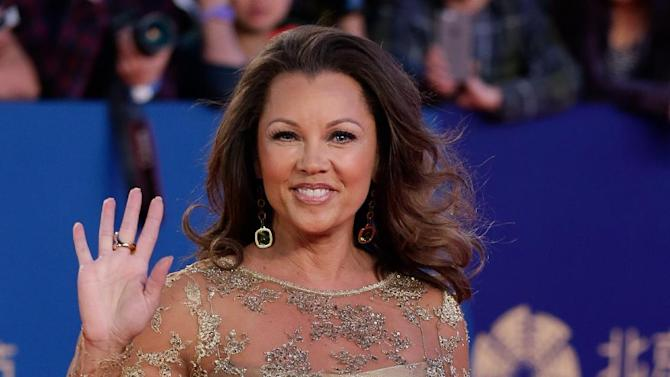FILE - In a Thursday, April 23, 2015 file photo, Vanessa Williams waves as she arrives on the red carpet for the closing ceremony of the 5th Beijing International Film Festival in the Huairou district of Beijing. Saturday, July 4, 2015. A representative for the singer-actress on Sunday, July 5, 2015 said Williams and her fiance, Jim Skrip wed on Saturday. No details of the ceremony were provided.  (AP Photo/Andy Wong, File)
