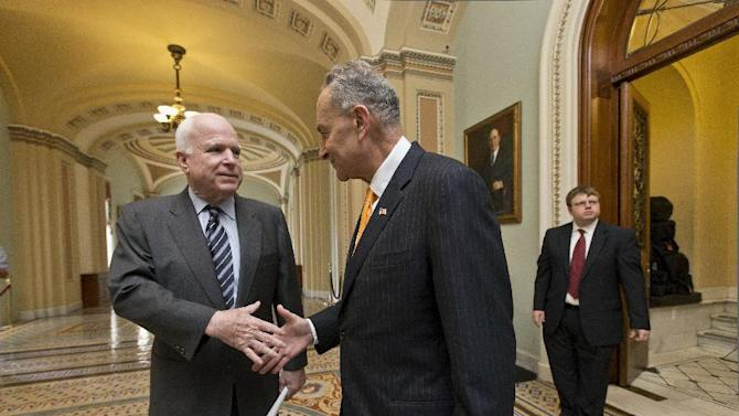 "Sen. John McCain, R-Ariz., left, and Sen. Charles Schumer, D-N.Y., right, two of the authors of the immigration reform bill crafted by the Senate's bipartisan ""Gang of Eight,"" shakes hands on Capitol Hill in Washington, Thursday, June 27, 2013, prior to the final vote. The historic legislation would dramatically remake the U.S. immigration system and require a tough new focus on border security. (AP Photo/J. Scott Applewhite)"