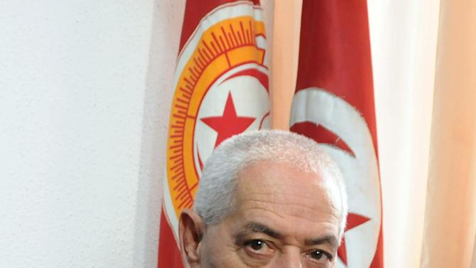 Houcine Abassi, secretary general of the Tunisian General Labour Union (UGTT), poses for a photograph in his office at the headquarters in Tunis, Tunisia, Friday, Oct. 9, 2015. Abassi is one of the four members of the Tunisian National Dialogue Quartet to be awarded the 2015 Nobel Peace Prize on Friday by the Norwegian Nobel Committee. (AP Photo)