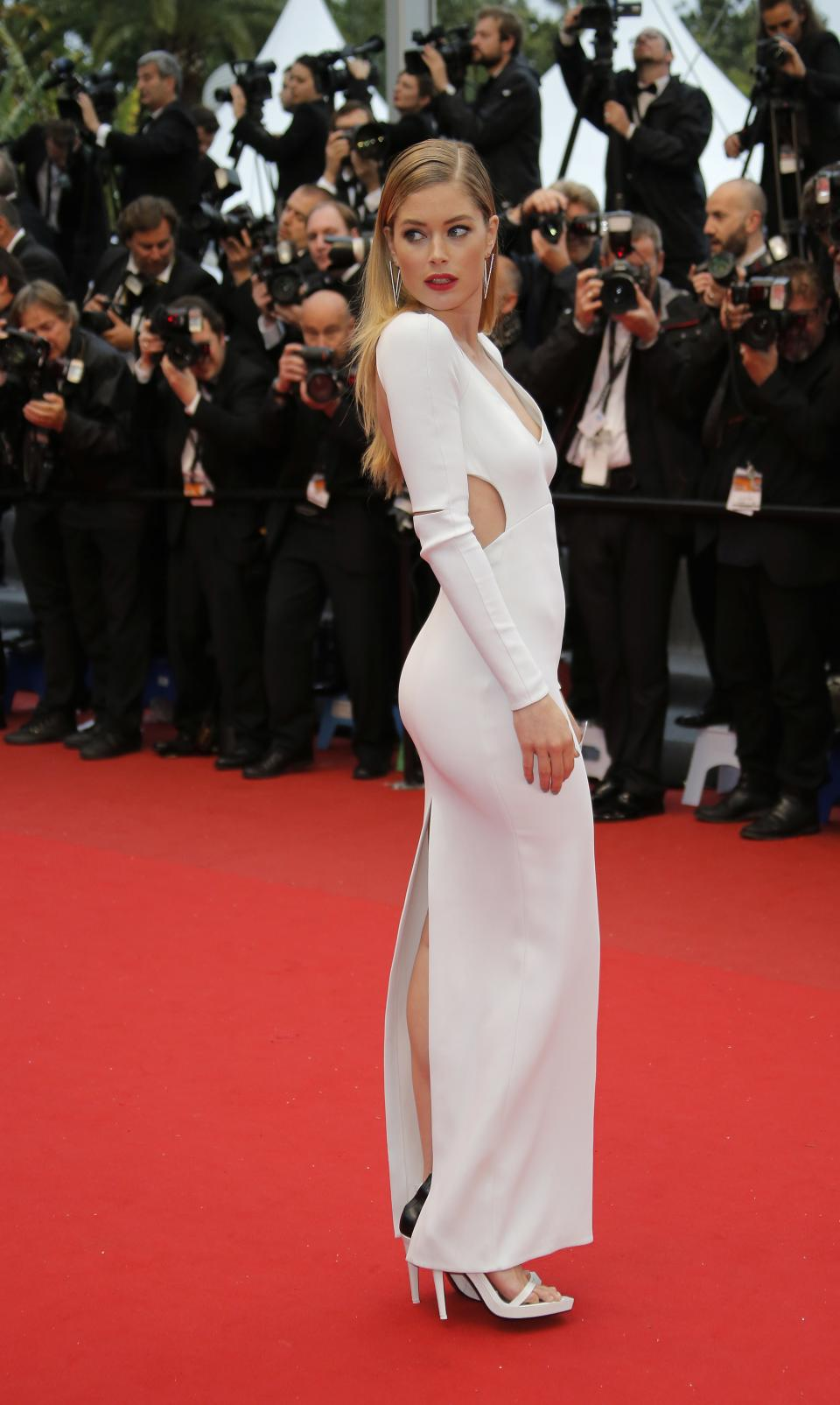 FILE - This May 18, 2013 file photo shows model Doutzen Kroes wearing an optic-white Calvin Klein gown with cutouts as she arrives for the screening of the film Jimmy P. Psychotherapy of a Plains Indian at the 66th international film festival, in Cannes, southern France. (AP Photo/Francois Mori, file)