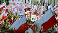 <p>People demonstrate in Warsaw against Poland's centrist government in a rally called by unions, an ultra-Catholic movement and politicians.</p>