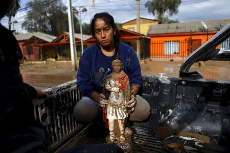Seven die in Chile floods, military rescues stranded residents