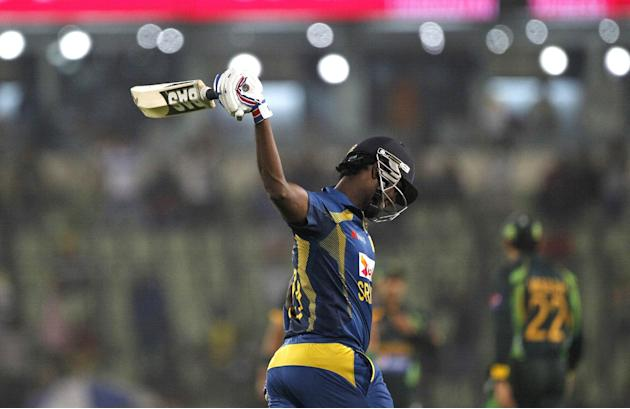Sri Lanka's cricket captain Angelo Mathews celebrates winning the Asia Cup final match against Pakistan in Dhaka, Bangladesh, Saturday, March 8, 2014