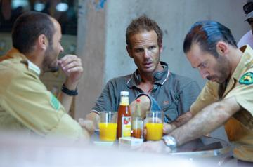 Ali Suliman , director Peter Berg and Ashraf Barhoum on the set of Universal Pictures' The Kingdom