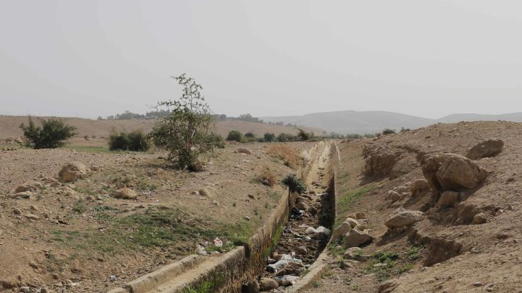 A dried out gulley usually flowing with natural spring water is seen in the Palestinian village of al-Auja, near Jericho