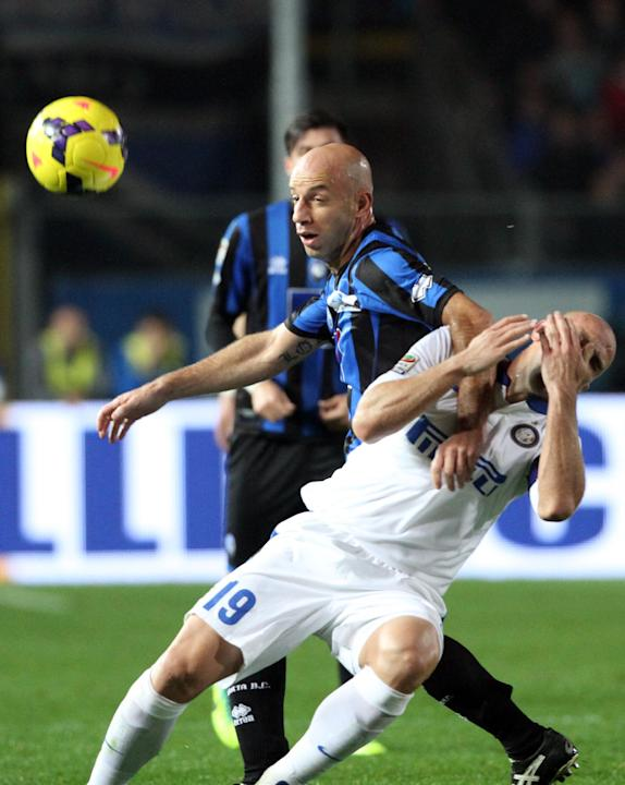 Inter Milan's Argentine Esteban Cambiasso, right, is fouled by Atalanta's Giulio Migliaccio during a Serie A soccer match in Bergamo, Italy, Tuesday, Oct. 29, 2013