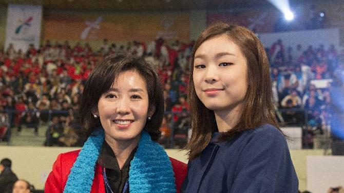 2013 Special Olympics World Winter Games Organizing Committ Chairwoman, Na Kyung-won, left, and Olympic gold medalist, Yuna Kim, gaze at the lens during the Special Olympics opening ceremony in PyeongChang, South Korea on Tuesday, Jan. 29, 2013. (Manchul Kim/AP Images for Special Olympics)