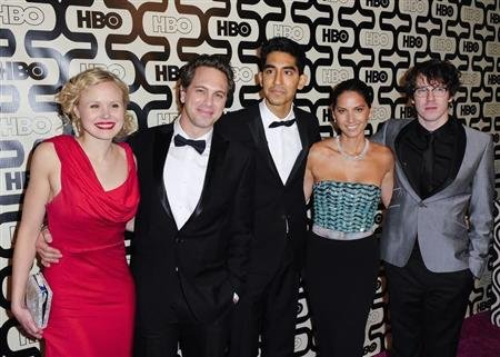 Cast members of the TV series &quot;The Newsroom&quot; (L-R) Alison Pill, Thomas Sadoski, Dev Patel, Olivia Munn and John Gallagher Jr. arrive at the HBO after party after the 70th annual Golden Globe Awards in Beverly Hills, California January 13, 2013. REUTERS/Gus Ruelas