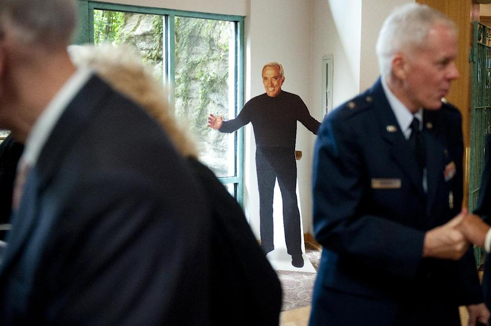 A cardboard cut-out of singer Andy Williams greets patrons to his memorial service at Moon River Theater in Branson, Mo., Sunday, Oct. 21, 2012. Williams passed away Sept. 25. (AP Photo/Grant Hindsley)