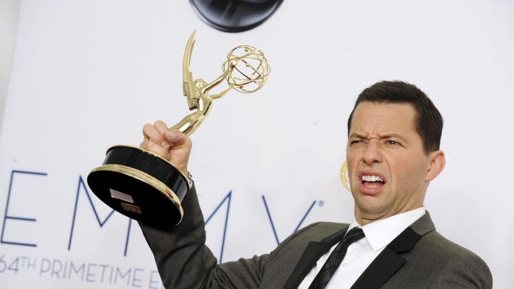 Actor Jon Cryer, winner of Outstanding Lead Actor in a Comedy Series, poses backstage at the 64th Primetime Emmy Awards at the Nokia Theatre on Sunday, Sept. 23, 2012, in Los Angeles. (Photo by Jordan Strauss/Invision/AP)