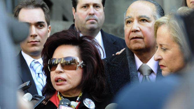 """FILE- In this March 8, 2011, file photo, Sylvia Cachay, mother of Sylvie Cachay, speaks to reporters outside State Supreme court in New York accompanied by her husband Antonio Cachay, right. Nicholas Brooks, whose father was an Oscar-winning composer who wrote """"You Light Up My Life,"""" was found guilty in the murder of his girlfriend, Sylvie Cachay, on Thursday, July 11, 2013. (AP Photo/Louis Lanzano, File)"""