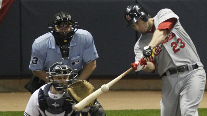 St. Louis Cardinals' David Freese hits a three-run home run during the first inning of Game 6 of baseball's National League championship series against the Milwaukee Brewers Sunday, Oct. 16, 2011, in Milwaukee. (AP Photo/Jeff Roberson)