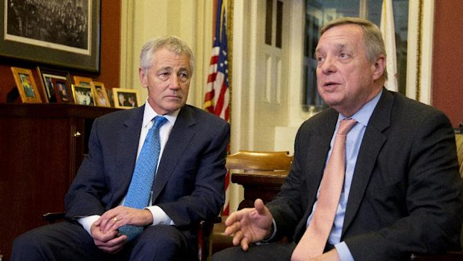Sen. Dick Durbin, D-Ill. with Secretary of Defense-nominee and former Sen. Chuck Hagel, R-Neb., speaks to journalists following their meeting on Capitol Hill in Washington, Tuesday, Jan. 22, 2013.   (AP Photo/Manuel Balce Ceneta)