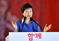 South Korea's ruling conservative party's presidential candidate, Park Geun-Hye (pictured in August), has hinted she would soften Seoul's stance towards Pyongyang and consider a summit with North Korean leader Kim Jong-Un, marking a shift from the approach of outgoing President Lee Myung-Bak