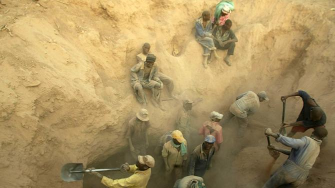 """FILE -- In this Wednesday, Nov. 1, 2006 file photo  miners dig for diamonds - Miners dig for diamonds in Marange, Zimbabwe At least $2 billion worth of diamonds have been stolen from Zimbabwe's eastern diamond fields and have enriched President Robert Mugabe's ruling circle, international gem dealers and criminals, according to an organization leading the campaign against conflict diamonds. Zimbabwe's Marange fields have seen """"the biggest plunder of diamonds since Cecil Rhodes,"""" the colonial magnate who exploited South Africa's Kimberley diamonds a century ago, charged Partnership Africa Canada, a member of the Kimberley Process, the world regulatory body on the diamond trade.  (AP Photo/Tsvangirayi Mukwazhi-File)"""