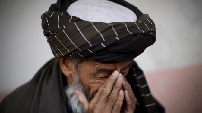 Hazratullah breaks down as he tells the story of his 21 year old son in U.S. Special Forces custody in Maidan Shahr, Wardak province, Afghanistan, Sunday, March 10, 2013. Afghan President Hamid Karzai, infuriated by villager reports of forced detentions and mass arrests, gave U.S. Special Forces two weeks to vacate Wardak province, located barely 30 kilometers (24 miles) from the Afghan capital of Kabul. The deadline for their withdrawal expired midnight Sunday, March 10, 2013. (AP Photo/Anja Niedringhaus)