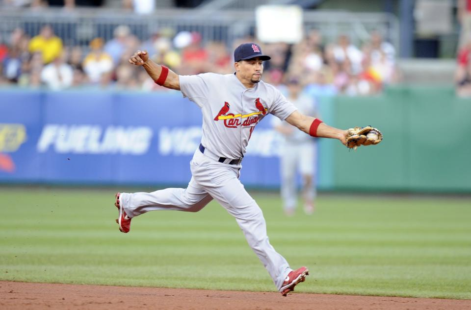 St. Louis Cardinals shortstop Rafael Furcal stops a ground ball from Pittsburgh Pirates' Ronny Cedeno (not pictured) during the second inning of a baseball game Tuesday, Aug. 16, 2011 in Pittsburgh.(AP Photo/Don Wright)