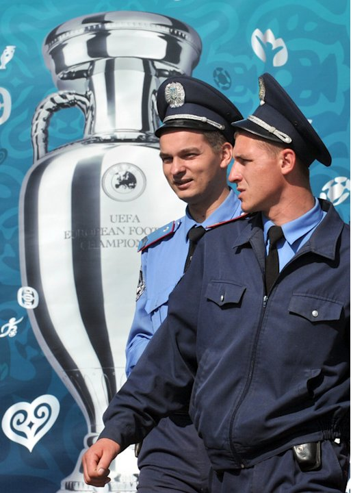 Police Officers Walk Pass A Placard Depicting The EURO 2012 Tournament Cup As They Stand Guard On Independence Square AFP/Getty Images