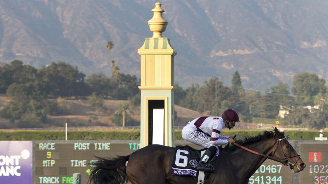 Royal Delta, ridden by jockey Mike Smith, crosses the finish line to win the Breeders' Cup Ladies' Classic horse race, Friday, Nov. 2, 2012, Arcadia, Calif. (AP Photo/Julie Jacobson)