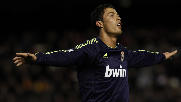 Real Madrid's Cristiano Ronaldo from Portugal celebrates after scoring against Valencia during their La Liga soccer match at the Mestalla stadium in Valencia, Spain, Sunday, Jan. 20, 2013. (AP Photo/Alberto Saiz)