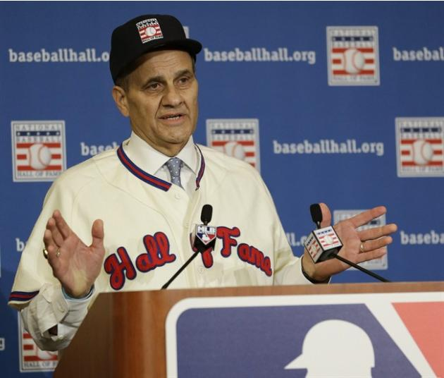 Joe Torre speaks at a news conference after it was announced that he, Tony La Russa, and Bobby Cox were unanimously elected to the baseball Hall of Fame at the MLB winter meetings in Lake Buena Vista,