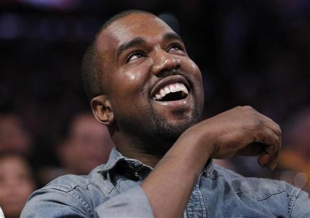 Recording artist Kanye West sits courtside as he attends the NBA basketball game between the Lakers and Bulls in Los Angeles