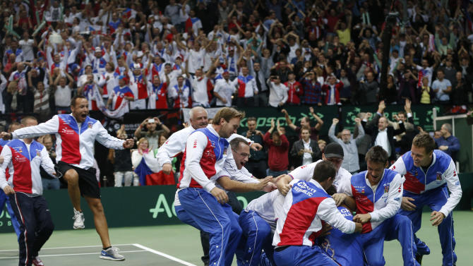 Czech Republic's team celebrates after Radek Stepanek, bottom, defeated Spain's Nicolas Almagro in their Davis Cup finals tennis singles match in Prague, Czech Republic, Sunday, Nov. 18, 2012. Czech Republic defeated Spain 3-2 and gained the Davis Cup trophy. (AP Photo/Petr David Josek)