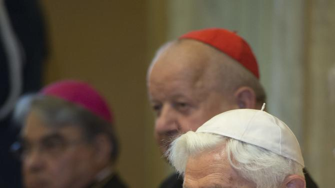In this pool photo taken on July 4, 2015 and made available on Monday, July 6, 2015, emeritus Pope Benedict XVI claps his hands during a ceremony where he received honorary doctorates from the Pontifical John Paul II University of Krakow and the Krakow Academy of Music for his promotion of respect for the traditions of sacred music in the Church at the papal summer retreat in Castel Gandolfo, a hill town near Rome. Since retiring from the papacy in 2013, Benedict has dedicated his time at the Vatican to prayer, meditation and classical music. (L'Osservatore Romano/Pool Photo via AP)