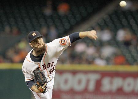 Keuchel matches home win milestone in Astros victory