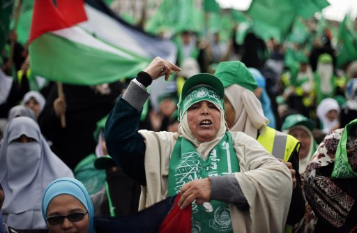 Palestinian Hamas supporters take part in a rally marking the 25th anniversary of the founding of Hamas, in Gaza City
