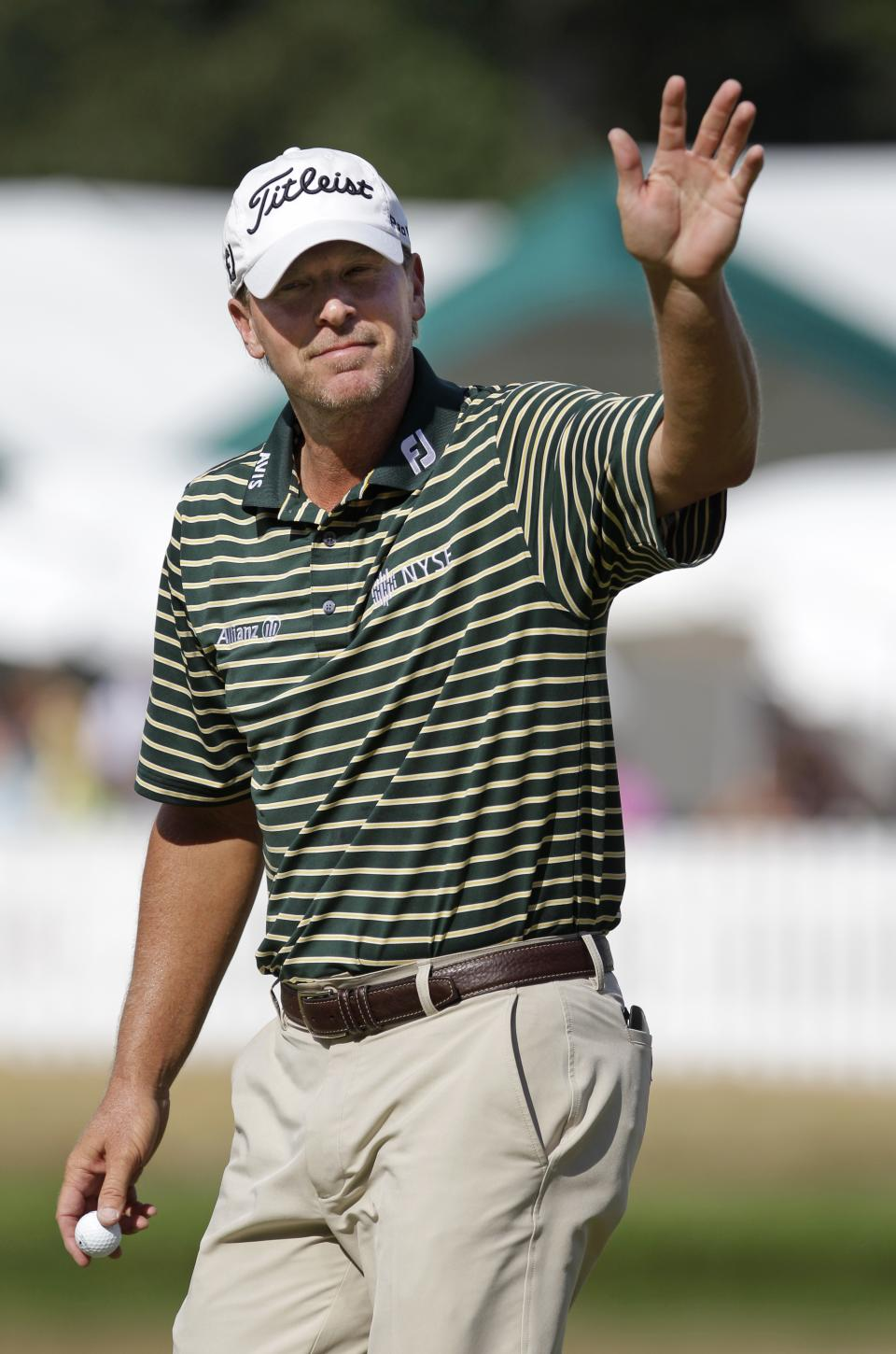 Steve Stricker waves to the crowd as he walks off the 18th green during the final round of the John Deere Classic golf tournament at TPC Deere Run, Sunday, July 15, 2012, in Silvis, Ill. (AP Photo/Charlie Neibergall)
