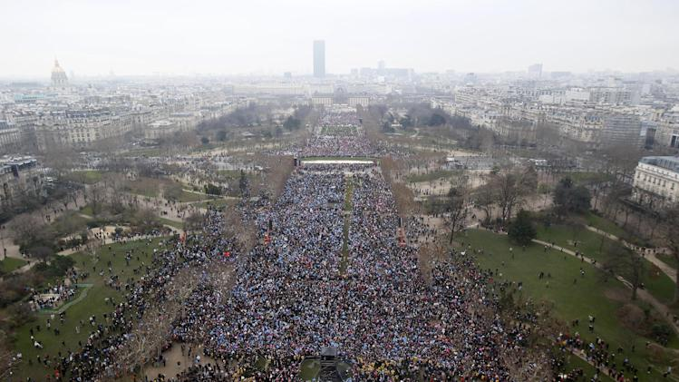 "Overhead view from the Eiffel Tower of thousands of people gathering on the ""Champs de Mars"", in Paris, Sunday, Jan. 13, 2013, protesting against the French president's plan to legalize gay marriage. (AP Photo/Michel Euler)"