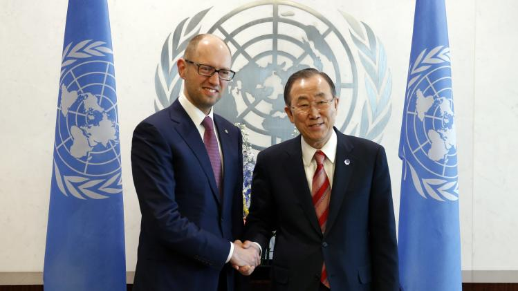 Ukraine Prime Minister Arseniy Yatsenyuk shakes hands with United Nations Secretary-General Ban Ki-moon at their meeting at U.N. Headquarters in New York