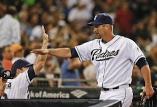 Lane high-fives teammates after making his first appearance in the majors since 2007. (AP)