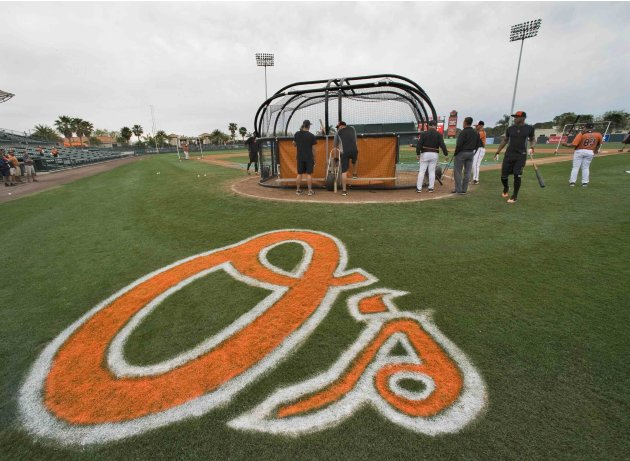 Baltimore Orioles players take batting practice during a workout before a MLB spring training baseball game with the Toronto Blue Jays in Sarasota, Florida