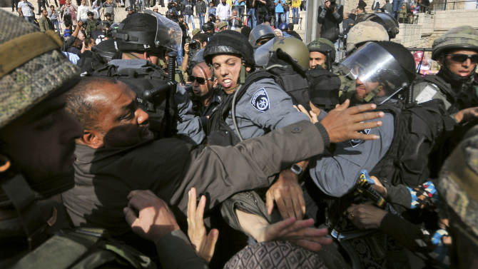 Israeli police and Muslim worshippers who were prevented from entering the Al-Aqsa mosque compound for prayers, scuffle in Jerusalem's Old City, Friday, Nov. 16, 2012. Israeli police was on high alert on Friday to prevent clashes following Friday prayers. (AP Photo/Mahmoud Illean),
