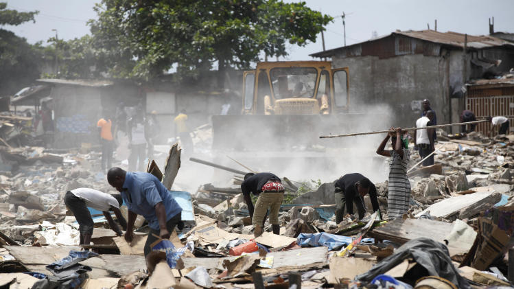 Nigeria's big city razes homes as poor left behind