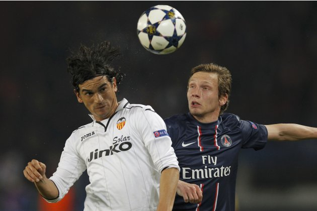 Paris St Germain's Chantome challenges Valencia's Costa during their Champions League soccer match in Paris