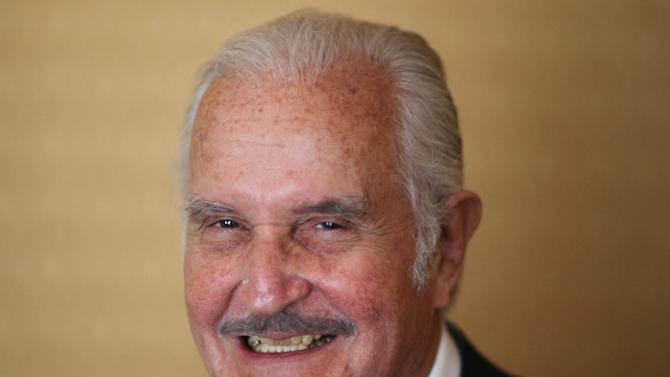 FILE - In this March 12, 2012 file photo, Mexican author Carlos Fuentes poses for a photo after a press conference in Mexico City. Fuentes, Mexico's most celebrated novelist and among Latin America's most prominent authors, died on May 15, 2012. (AP Photo/Alexandre Meneghini, File)