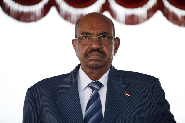 Sudanese President Omar Hassan al-Bashir stands for the national anthem on arrival at Bole International airport for the 21st Ordinary Session of the African Union in Addis Ababa