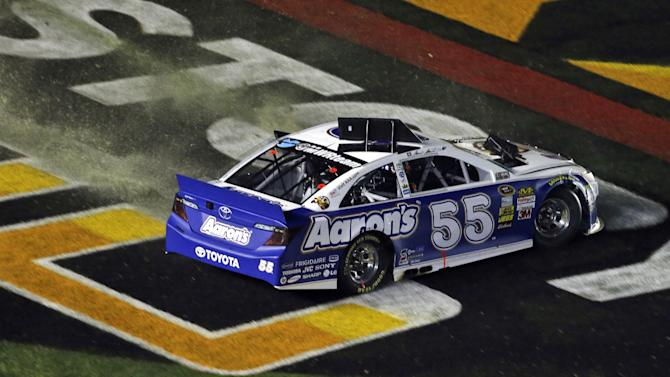 Mark Martin (55) spins through the front-stretch apron during the NASCAR Sprint Cup Series All-Star auto race at Charlotte Motor Speedway in Concord, N.C., Saturday, May 18, 2013. (AP Photo/Gerry Broome)