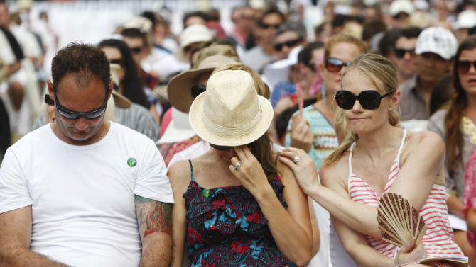 Australian relatives of the victims of the 2002 Bali bombings comfort each other during a memorial service, marking the 10th anniversary of the terrorist attacks at nightclubs in Kuta that killed 202 people, including 88 Australians and seven Americans, in Jimbaran in Bali, Indonesia, Friday, Oct. 12, 2012. (AP Photo/Made Nagi, Pool)
