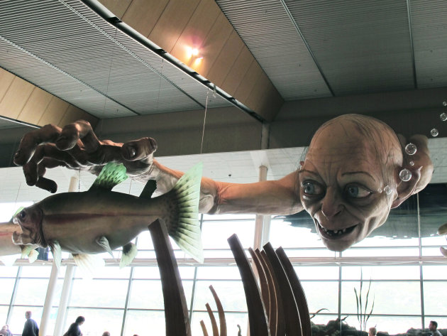 "In this photo taken Saturday, Nov. 24, 2012, a giant sculpture of Gollum, a character from ""The Hobbit,"" is displayed in the Wellington Airport to celebrate the upcoming premiere of the first movie in the trilogy, in Wellington, New Zealand. The sculpture was created at Weta Workshop, part of Peter Jackson's movie empire in the Wellington suburb of Miramar. The world premiere of ""The Hobbit: An Unexpected Journey"" is Nov. 28 at Wellington's Embassy Theatre. (AP Photo/Nick Perry)"