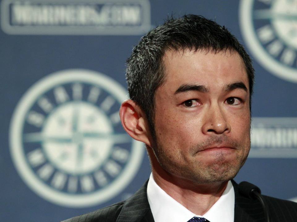 New York Yankees' Ichiro Suzuki pauses after being asked to share some of his most memorable moments with the Seattle Mariners during a news conference, Monday, July 23, 2012, in Seattle. The Mariners announced that Suzuki, who has played with the Mariners since 2001, was traded to the Yankees. (AP Photo/Elaine Thompson)